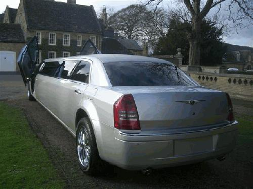 Chauffeur stretch Chrysler C300 Baby Bentley limousine with Lamborghini doors in East of England, Peterborough, Huntingdon, Stanford, King's Lynn, Norwich, Great Yarmouth, Lowestoft, Wisbech, Spalding, Cambridge, Cambridgeshire, Bedford, Bedfordshire, Newmarket, Bury St Edmunds, Suffolk, Norfolk, Lincolnshire, Northampton, Northamptonshire, Kettering, Leicester and Sudbury.