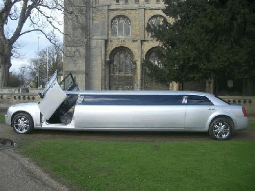 Chauffeur stretched Chrysler C300 Baby Bentley limo with Lamborghini doors in East of England, Peterborough, Huntingdon, Stanford, King's Lynn, Norwich, Great Yarmouth, Lowestoft, Wisbech, Spalding, Cambridge, Cambridgeshire, Bedford, Bedfordshire, Newmarket, Bury St Edmunds, Suffolk, Norfolk, Lincolnshire, Northampton, Northamptonshire, Kettering, Leicester and Sudbury.