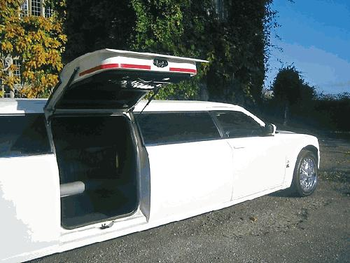 Chauffeur driven stretch limousine white Chrysler C300 Baby Bentley with jet doors available in Brighton, Eastbourne, Hastings, Portsmouth, Crawley, Tunbridge Wells, Lewes, Worthing, Chichester, Bognor Regis, Horsham, East Grinstead, East Sussex and West Sussex.