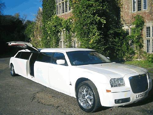 Chauffeur driven stretch limo white Chrysler C300 Baby Bentley with jet doors available in Brighton, Eastbourne, Hastings, Portsmouth, Crawley, Tunbridge Wells, Lewes, Worthing, Chichester, Bognor Regis, Horsham, East Grinstead, East Sussex and West Sussex.