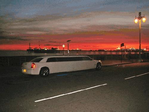 Chauffeur stretched limousine white Chrysler C300 Baby Bentley with jet doors available in Brighton, Eastbourne, Hastings, Portsmouth, Crawley, Tunbridge Wells, Lewes, Worthing, Chichester, Bognor Regis, Horsham, East Grinstead, East Sussex and West Sussex.