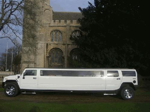 Chauffeur driven stretched white H2 hummer limousine 16 seater in East of England, Peterborough, Huntingdon, Stanford, King's Lynn, Norwich, Great Yarmouth, Lowestoft, Wisbech, Spalding, Cambridge, Cambridgeshire, Bedford, Bedfordshire, Newmarket, Bury St Edmunds, Suffolk, Norfolk, Lincolnshire, Northampton, Northamptonshire, Kettering, Leicester and Sudbury.