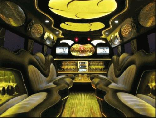 Chauffeur driven stretch yellow 8-wheeler triple axle H2 hummer limousine interior in Manchester, Liverpool, Cheshire, Chester, Stockport, North West, Blackburn, Preston, Bolton, Wigan, Lancashire.