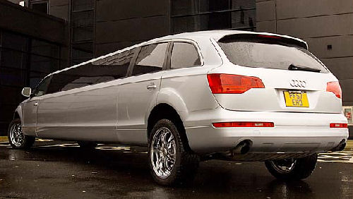 Chauffeur stretched silver Audi Q7 limousine hire in Glasgow, Edinburgh, Scotland.