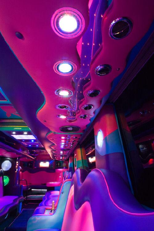 Chauffeur driven Party Bus limousine hire interior in Bristol, Gloucester, Cheltenham, Cardiff, Wales, Weston Super Mare, and Bath.