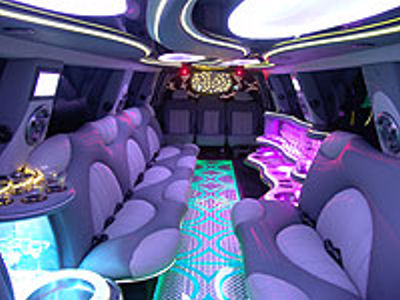 Chauffeur stretch pink Hummer H2 limousine hire interior in UK