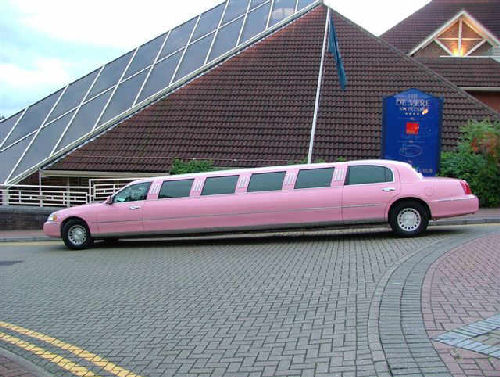 Chauffeur stretched pink Lincoln limousine hire in Bristol, Gloucester, Cheltenham, Cardiff, Wales, Weston Super Mare, and Bath.