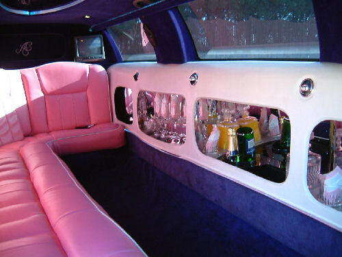 Chauffeur stretched pink Lincoln limousine hire interior in Sheffield, Rotherham, Doncaster, Chesterfield, South Yorkshire