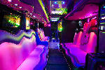 Chauffeur driven Party Bus limousine hire Playboy den interior in Bristol, Gloucester, Cheltenham, Cardiff, Wales, Weston Super Mare, and Bath.
