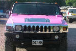 Chauffeur stretched pink Hummer H2 limo hire in Bristol, Gloucester, Cheltenham, Cardiff, Wales, Weston Super Mare, and Bath.